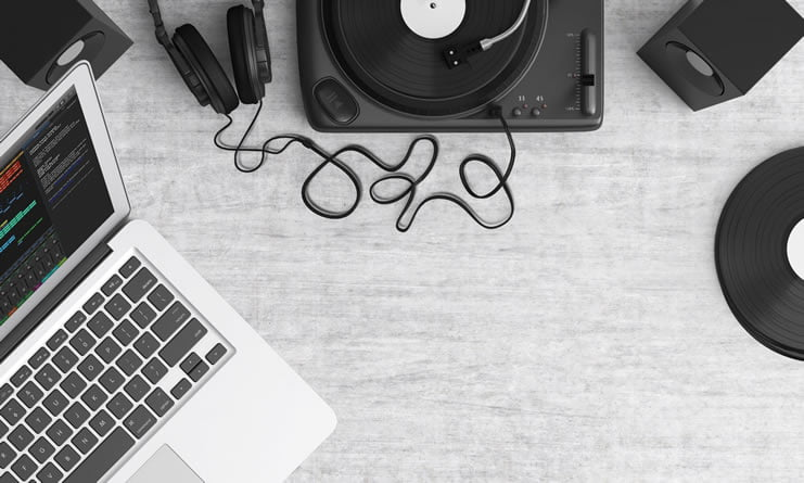 https://www.pexels.com/photo/macbook-pro-beside-black-headphones-on-gray-table-159376/
